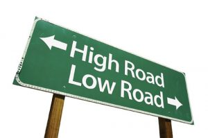 "Sign showing ""high road"" and ""low road"" symbolizing the importance of good conduct in the courtroom"